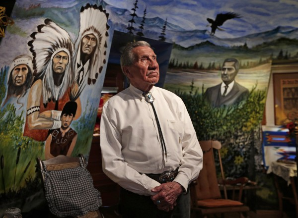 Robert F. Bukaty | BDN Charles Norman Shay views the murals painted on the interior walls of his teepee on Indian Island. He is depicted as a young boy at lower left
