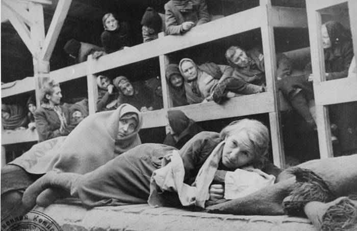 Women in the barracks of the newly liberated Auschwitz concentration camp. —US Holocaust Memorial Museum, courtesy of National Archives and Records Administration, College Park